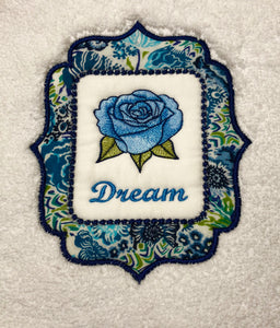 bath towe embroidered with word dream