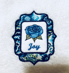 wash towel embroidered with word joy