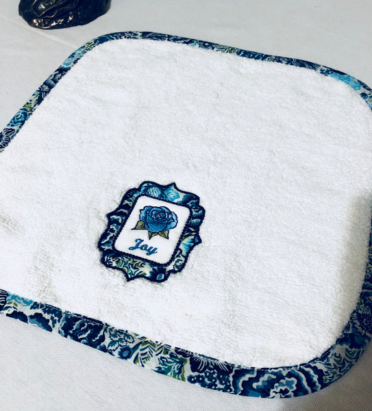 wash towel embroidered with joy and blue piping around