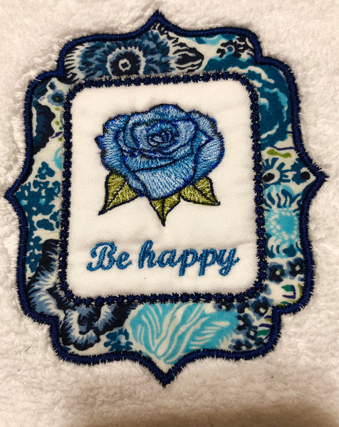 hand towel embroidered with words be happy