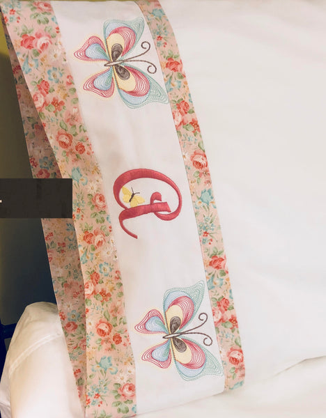 monogrammed pillow case and embroidered with butterflies
