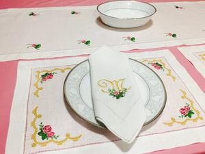 collection of table linens embroidered with roses