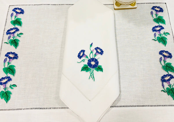 linen placemat and linen dinner napkins embroidered with purple morning glory flowers
