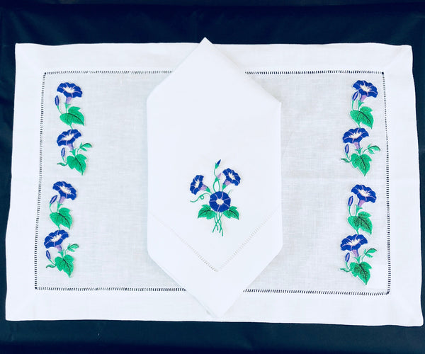 matching placemat and dinner napkins embroidered with morning glory flower desing