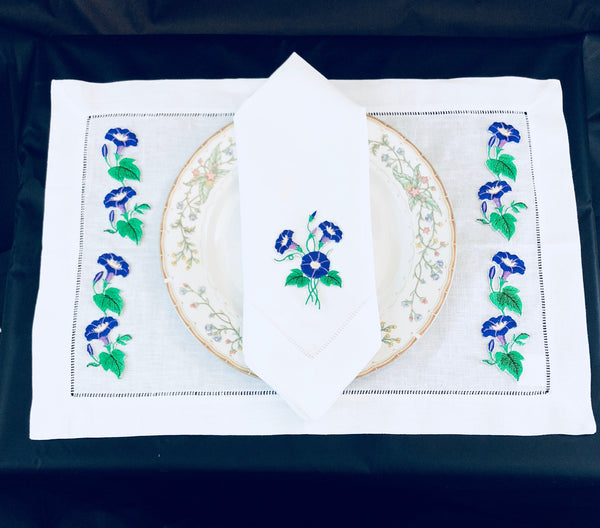 linen placemat and linen dinner napkins embroidered with purple morning glory flower design