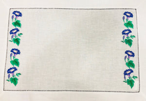 linen placemat embroidered with morning glory flowers