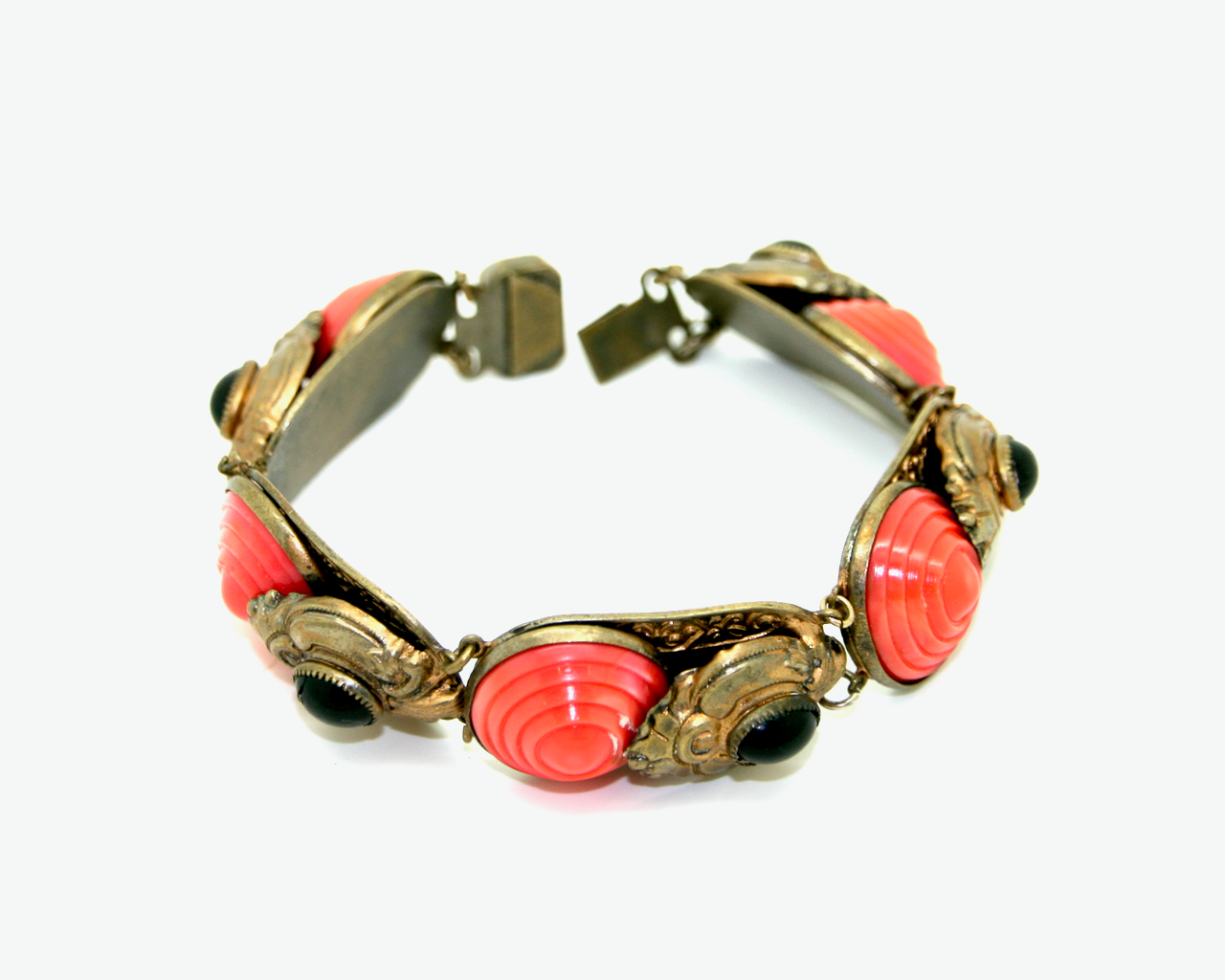 1920's coral and black glass brass panel bracelet