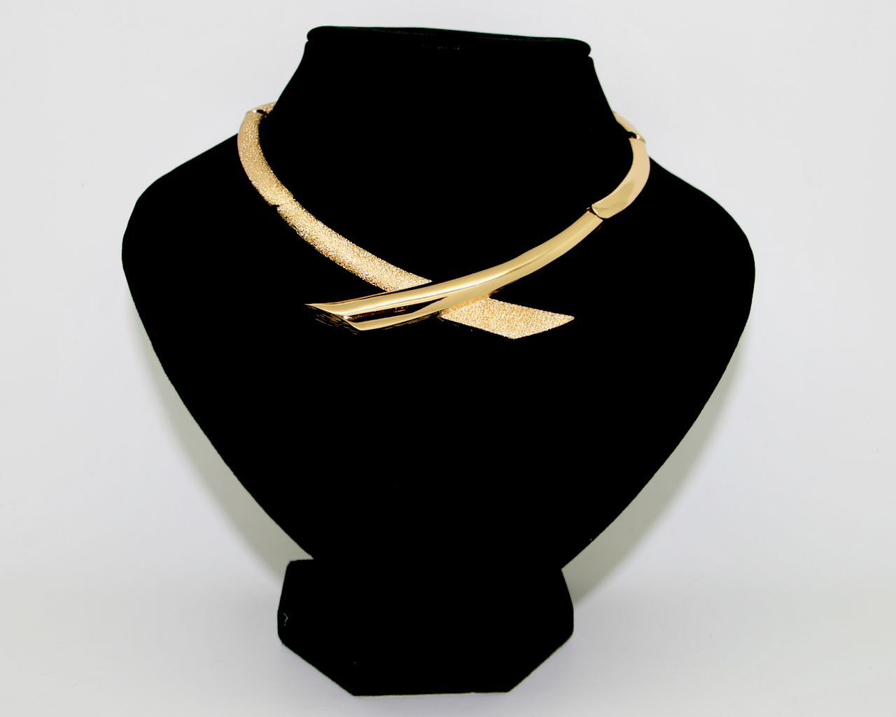1970's MONET textured and smooth gold articulated crossover necklace