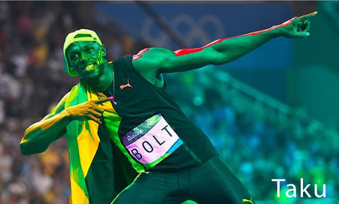 Usain Bolt Covered in Color