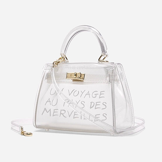 Women's transparent handbag with graffiti text and gold hardware