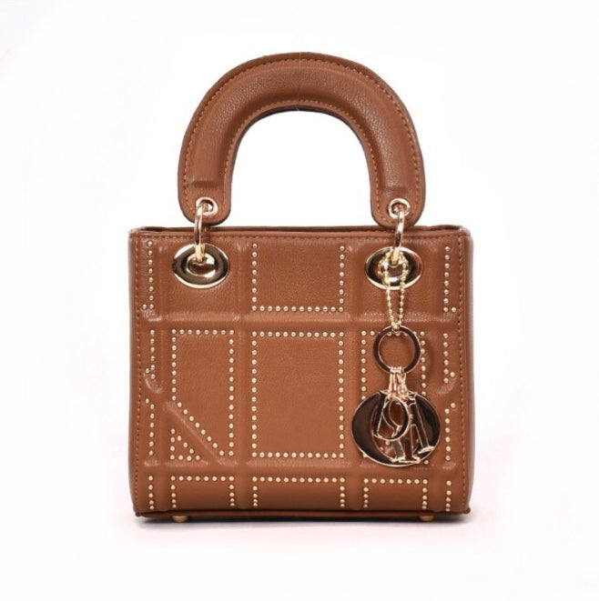 Women's tan handbag with gold studded detail and top handle