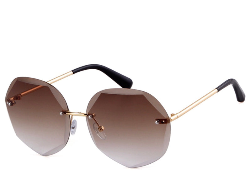 Women's stylish round brown tint sunglasses