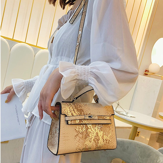 Ladies pastel yellow metallic effect croc bag with silver hardware