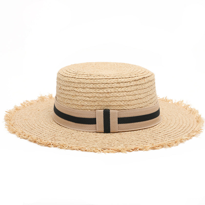 Women's boater straw hat with frayed edging and black ribbon detail
