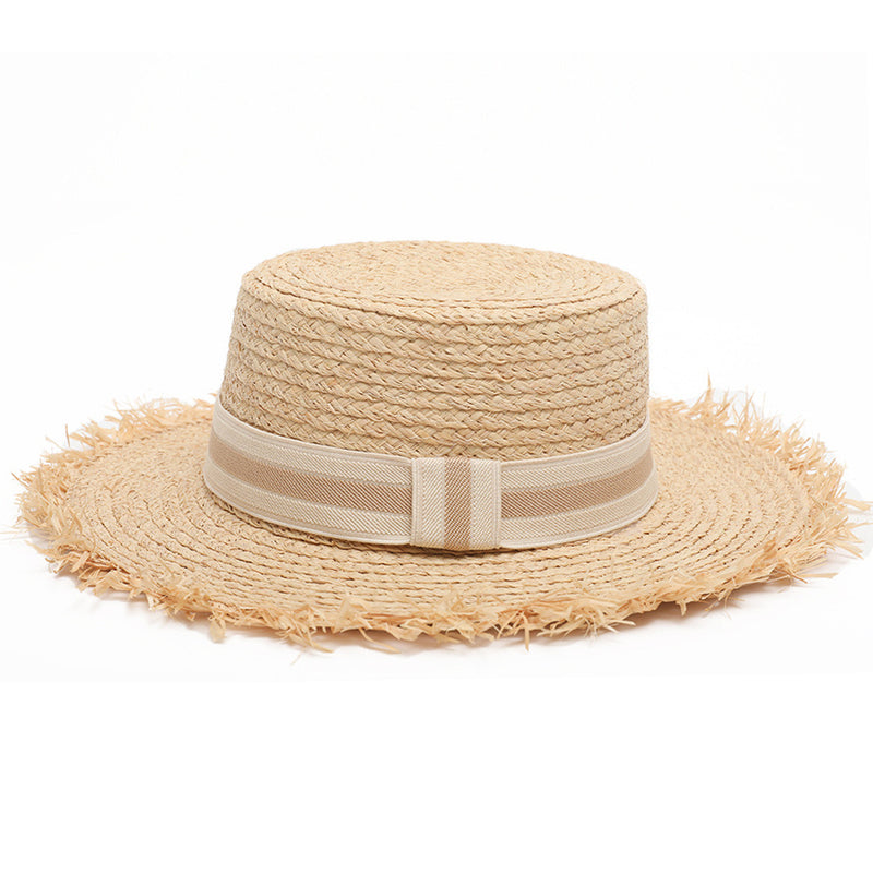 Women's boater straw hat with frayed edging and nude ribbon detail