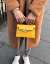 Women's yellow vegan faux leather mini handbag with gold hardware