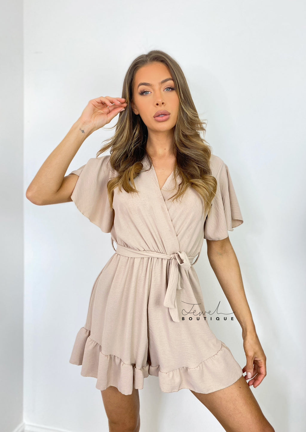 Women's nude belted ruffle playsuit