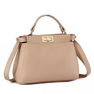 Ladies nude faux leather handbag with gold hardware