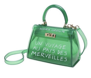 Women's semi transparent green handbag with graffiti writing and gold hardware