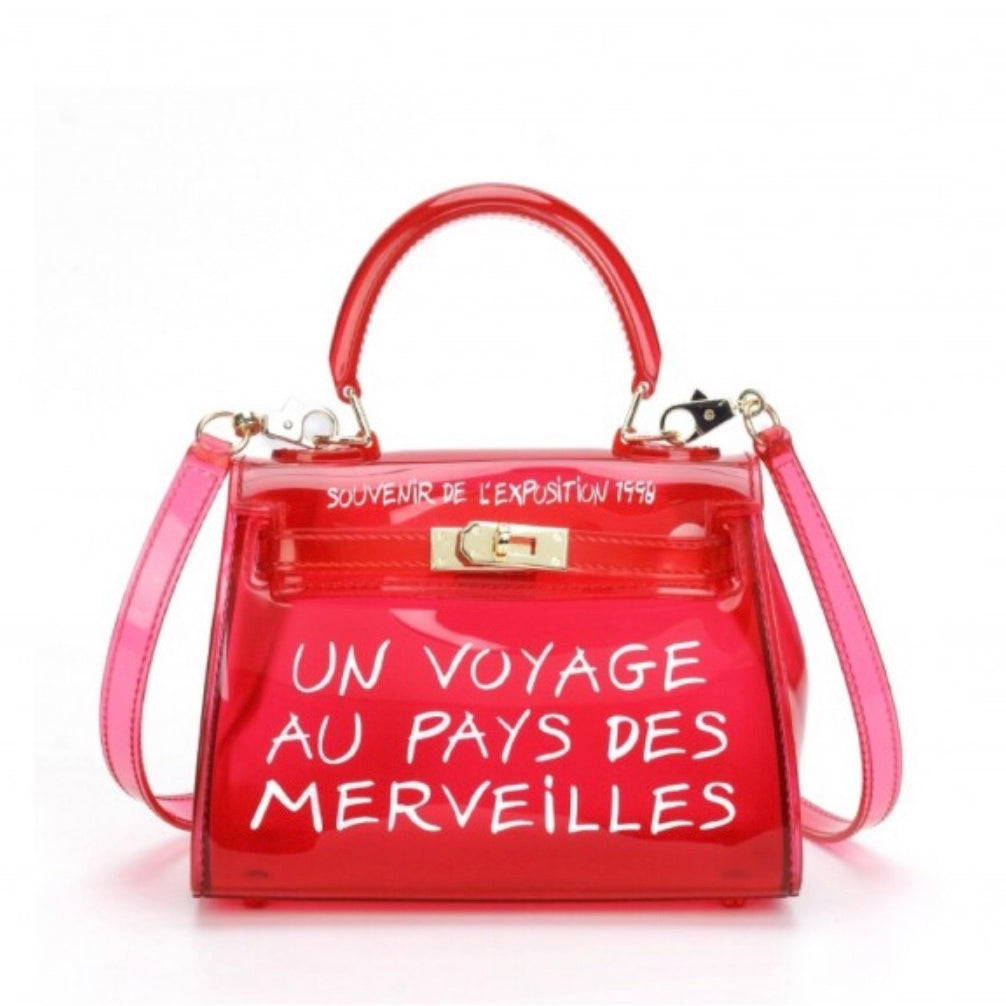 Women's perspex effect red handbag with graffiti writing
