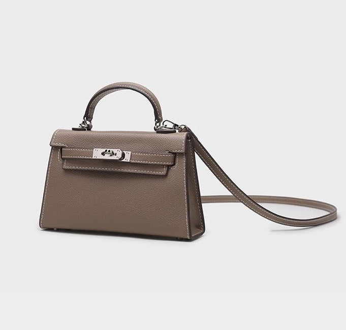 Women's taupe vegan faux leather mini handbag with silver hardware