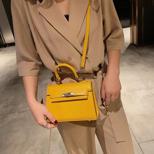 Women's stylish yellow handbag with silver detail