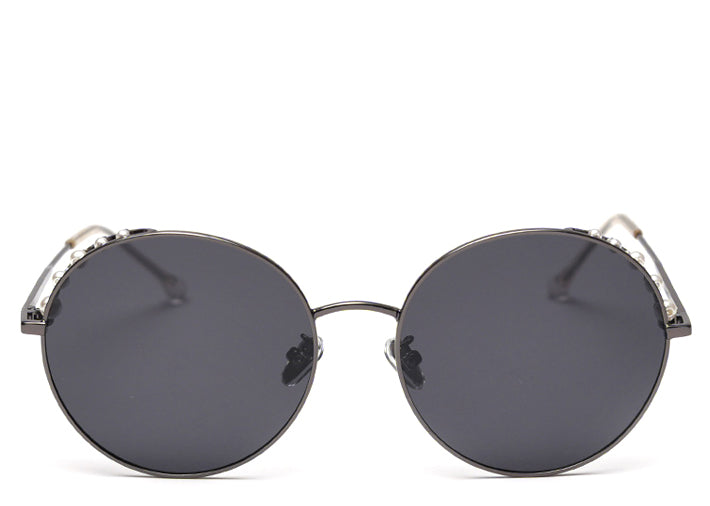 Women's round black polarised sunglasses with pearl detail