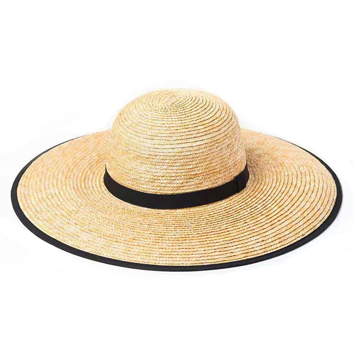 Women's straw wide brim stetson hat with black ribbon detail