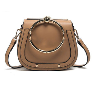 Women's fashionable tan handbag with gold ring handle