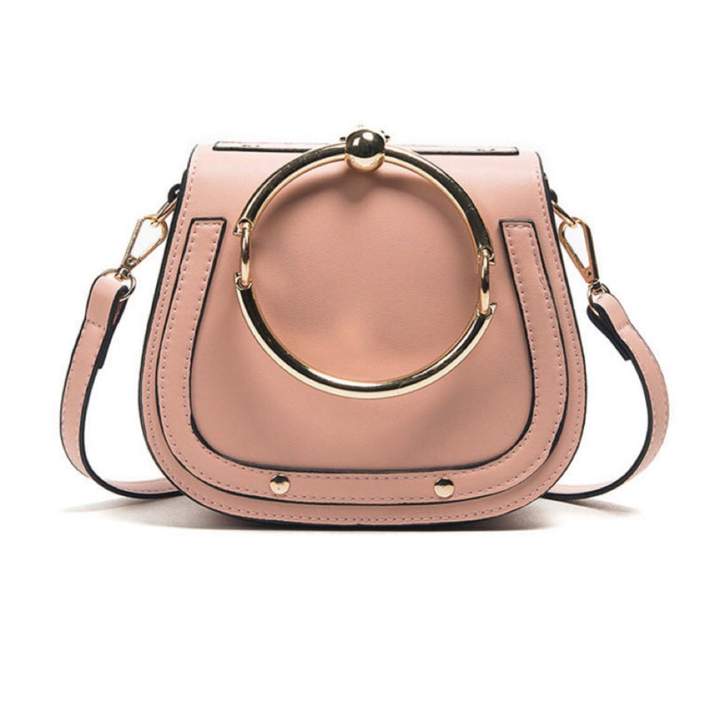 Women's fashionable pink handbag with gold ring handle
