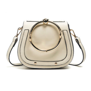 Women's fashionable cream handbag with gold ring handle
