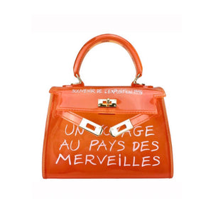 Women's orange perspex effect handbag with graffiti writing
