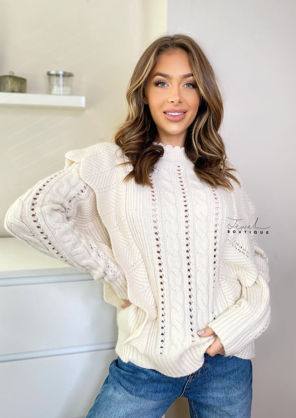 Women's cream coloured ruffle and cable knit jumper