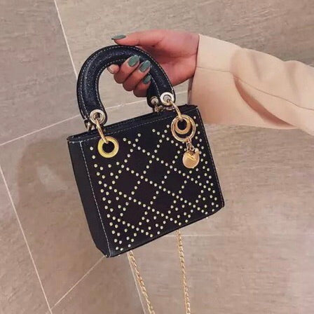 Women's black and gold metallic studded handbag with top handle