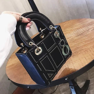Women's black handbag with gold studded detail