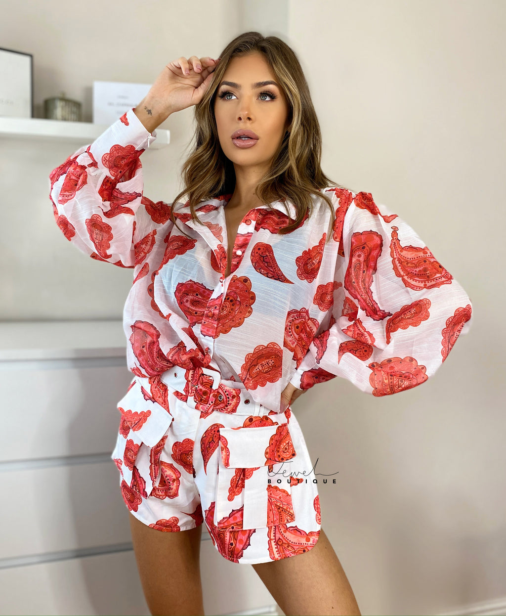 Red and white printed women's co-ord set with blouse and shorts