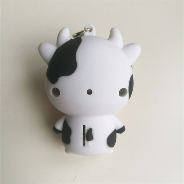 Coupcou.com: Noise-Making Cartoon Cow Keychain with LED Light