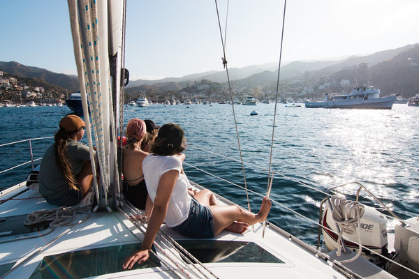 11 Out of the Ordinary Hangout Ideas. Friends hanging out on a boat on sunny day.