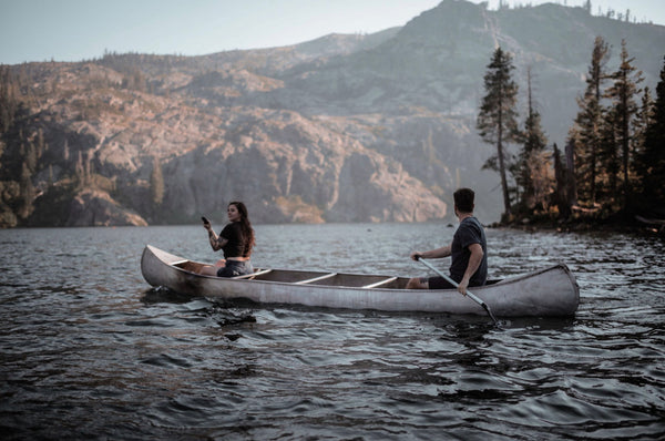 11 Out of the Ordinary Hangout Ideas. Couple kayaking in the lake.