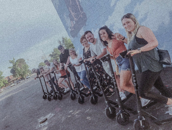 11 Out of the Ordinary Hangout Ideas. Friends on scooters smile as they are about to go explore the city.
