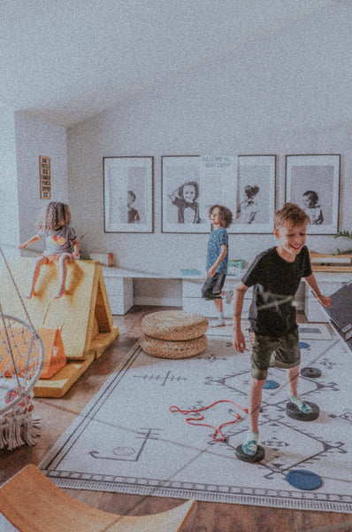 Kids making their own obstacle course and playing The Floor is Lava