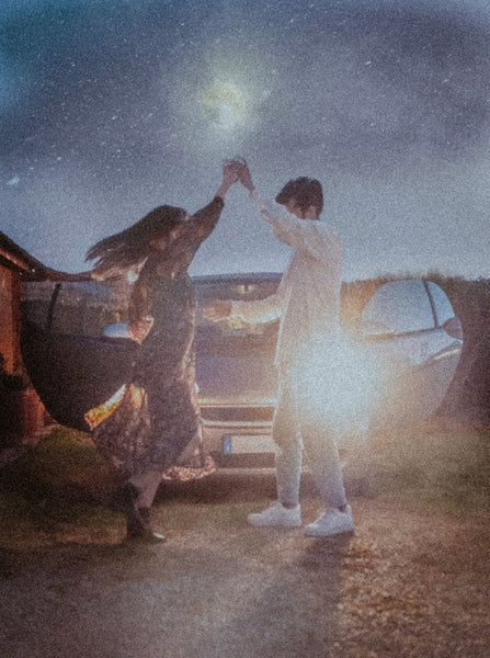Cheap Date Ideas (That Don't Feel Cheap). Couple dances under the stars with their car behind them.