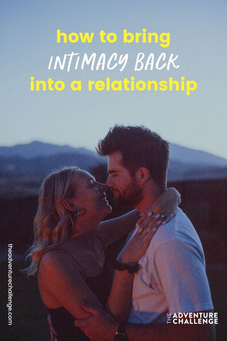 Couple smile while sharing a hug as it approaches nighttime; image overlaid with text that reads How to Bring Intimacy Back Into a Relationship