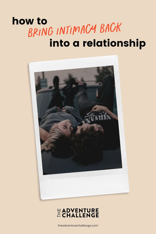 Couple lie back and smile as they face each other; image overlaid with text that reads How to Bring Intimacy Back Into a Relationship