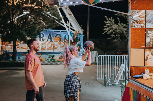 How to Have Better Sex In a Relationship. Couple playing basketball at the fair.