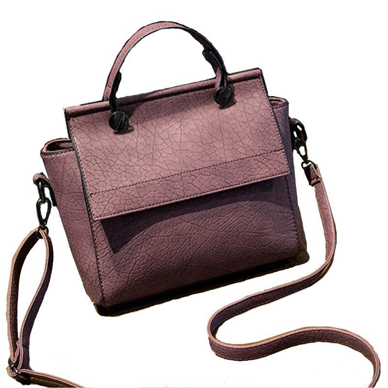 The Trapeze Tote Leather Handbags.