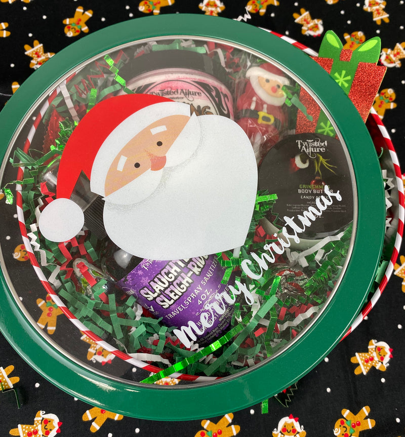 Small red and white stripped Santa round Tin