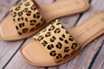 THE SPOTTED LEOPARD SLIP ON SANDALS