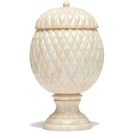 Made Goods Alatea Urn is made of bone with a pineapple motiff.
