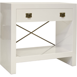 Worlds Away Dalton white lacquer nightstand with a cubby shelf, glide drawer, brass X-brace and drawer pulls.
